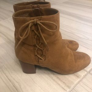 Brown booties with tied bows